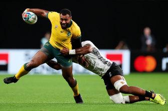 Kerevi is tackled by Dominiko Waqaniburotu during Australia's World Cup win over Fiji.