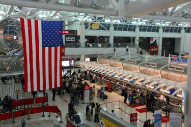 New York: People hurry at Kennedy Airport in New York. In 2012, the airport handled 49.3 million passengers (6th busiest in the United States).