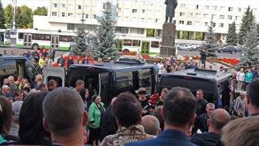 People gather for the funerals of five Russian nuclear engineers killed by a rocket explosion in Sarov.