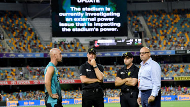 Chris Lynn (left) of the Heat is seen talking to the match officials after play was abandoned.