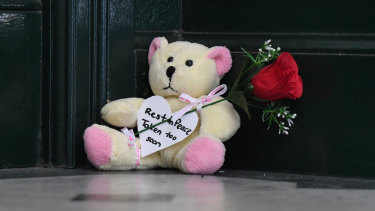 A teddy bear and rose left on the steps of Clarence House after Michaela Dunn was killed there on Tuesday.