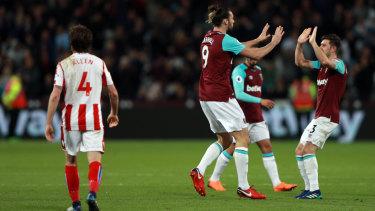 Happy returns: West Ham United's Andy Carroll (centre) celebrates scoring the equaliser.