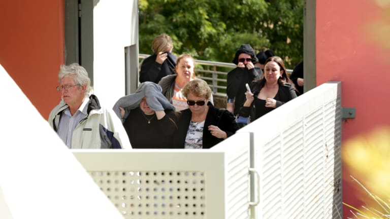 A group leaves court on Wednesday following David McCauley's appearance.