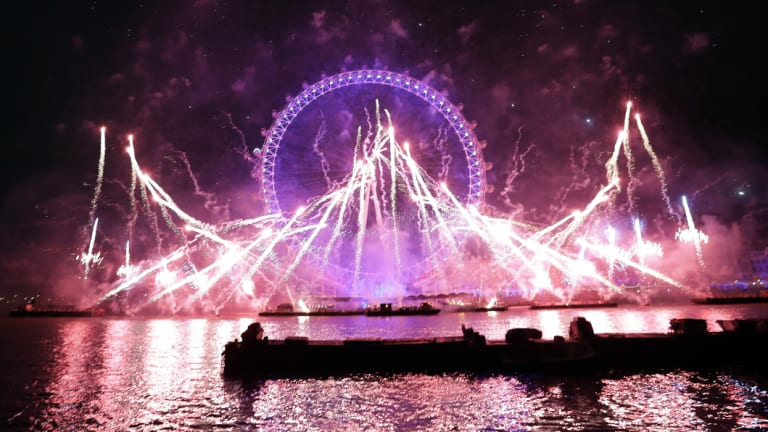 Fireworks explode over the London Eye.