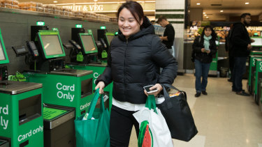 Sylvia Bui, a nursing student, leaving a Woolworths store in central Sydney with her reusable shopping bags on Wednesday.