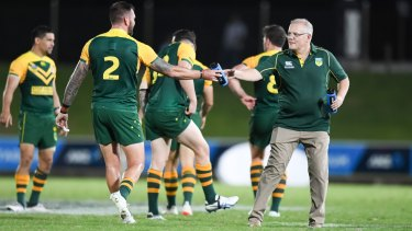 Prime time: Scott Morrison keeps his men hydrated in Suva on Friday night.