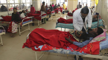 A doctor attends to a victim, who had consumed bootleg liquor, at a hospital in Jorhat in north-eastern state of Assam, India, on Saturday.