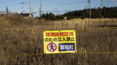 "A sign reads ""Do not enter"" along Route 6 in Tomioka near the Fukushima Daiichi nuclear plant."