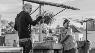 Four-time nominee Alfonso Cuaron, left, and best actress contender Yalitza Aparicio on the set of Roma.