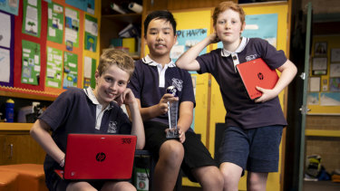 Year 6 students Caleb Jeremy, Sirapuk Wateesatogkij and Monty Rooney from Forest Lodge Public School are heading to Japan to represent Australia in an international robotics competition.