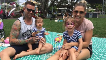 Aaron Roberts, partner Dimity and daughters Charlotte and Sophie say growing South Bank around the river would be too far to walk for small children.