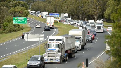 'Like New Year's Eve': Queensland border reopens, some cars turned back