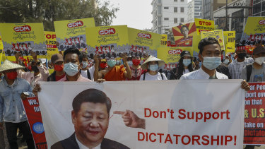 Demonstrators display a picture of Chinese president Xi Jinping, with a message requesting not to support military coup during a protest against the military coup in Mandalay, Myanmar.