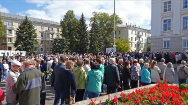 People gather for the funerals of five Russian nuclear engineers killed by a rocket explosion in Sarov, the closed city, located 370 kilometres east of Moscow.
