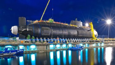 Britain's third Astute Class nuclear submarine, the Artful, being lowered into the water.