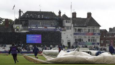 Ground staff pull rain covers on at Trent Bridge.