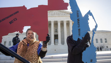 Activists gathered outside the US Supreme Court in March as it heard separate cases on gerrymandering and the census.