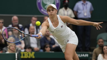 Australia's Ashleigh Barty on her way to victory over Ajla Tomljanovic and a place in the Wimbledon semi-finals.