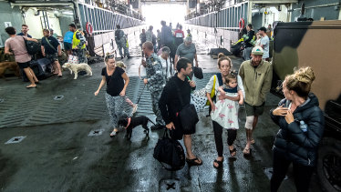The first group of evacuees from Mallacoota have been welcomed aboard the HMAS Choules.