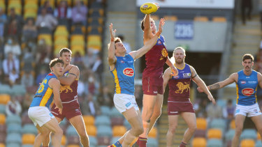 The Lions and Suns going head-to-head at the Gabba earlier this season.