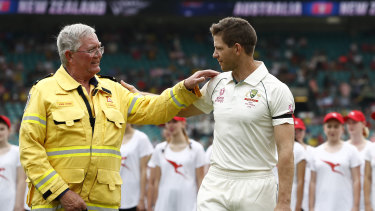 Australia captain Tim Paine greets John Corry of the Ku-ring-gai Fire Brigade on Friday.