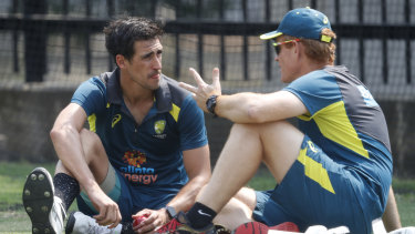 Andrew McDonald chats with Mitchell Starc during training for the Boxing Day Test.