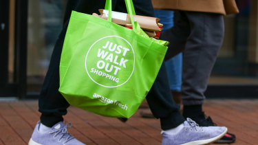 Just walk out: a customer carries a reusable bag after shopping at a cashierless store.