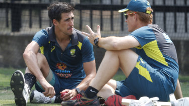 Andrew McDonald chats with Mitchell Starc during training for the Boxing Day Test in 2019.