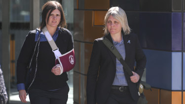 Emma-Kate McPherson , left, and her partner Kathryn Lee Richens at the Federal Court on Monday.