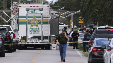 Polk County Sheriff's officials work the scene of a multiple fatality shooting.