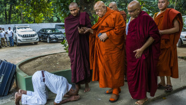A Sri Lankan Buddhist bows in front of Sitagu Sayadaw, one of Myanmar's most revered Buddhist leaders, in Delgoda, Sri Lanka.