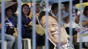 Supporters of opposition senatorial candidates rally in suburban Quezon city, northeast of Manila, Philippines.