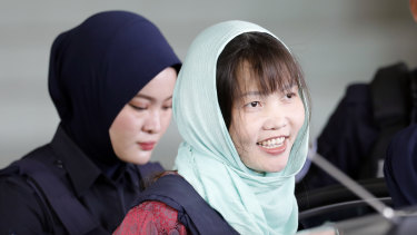 Doan Thi Huong, right, leaves Shah Alam High Court in Malaysia on Monday after pleading guilty to causing harm.