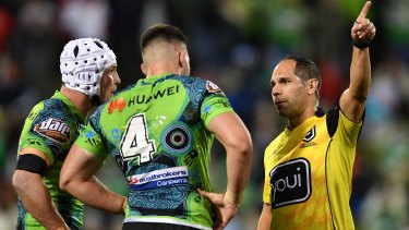 Nick Cotric is sent off by referee Ashley Klein against the Dragons at WIN Stadium.