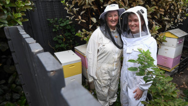 Kirsten Roach and her daughter Jaimes Bowe at home in Blackburn with their bees in the house Ms Roach will sell to take her  corporate work-life remote in a new home in Bairnsdale.