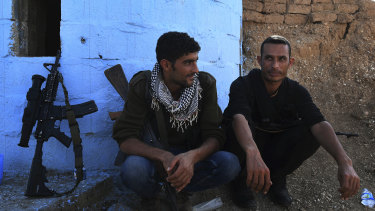 YPG soliders Maslum Hassakeh and Zenar Zenar rest at a checkpoint 10km from the front line.