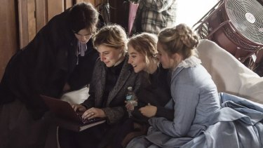 Emma Watson, director Greta Gerwig, Saoirse Ronan and Florence Pugh on the set of Little Women.