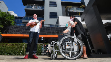 Fringe legend Ian Pidd singing and playing his ukulele for resident Josie (centre) and Angela at Mercy Place, Parkville.