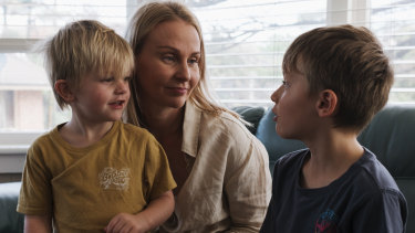 Sandy Smith and two of her four boys - Emmett (8) and Reid (4) at their family home in Austinmer.  Sandy Smith's husband Kurt took his own life in April 2017.