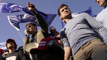 Right-wing podcaster Nick Fuentes, center, speaking to supporters of President Donald Trump during a pro-Trump march in November.