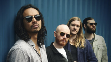 The Temper Trap and singer Dougy Mandagi (left) are marking the 10th anniversary of breakthrough single Sweet Disposition.