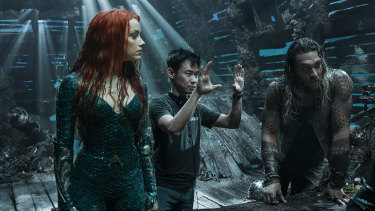 James Wan directs Amber Heard and Jason Momoa on the Queensland set of the movie.