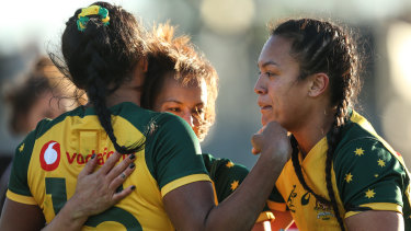 Dominant: Mhicca Carter scores a try for the Wallaroos.