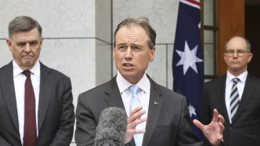 Secretary of the Department of Health Professor Brendan Murphy, Health Minister Greg Hunt and Chief Medical Officer Professor Paul Kelly  during a press conference on the COVID-19 vaccine road map on Thursday.