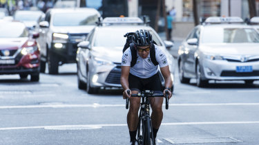 A cyclist rides up King Street, Sydney CBD.