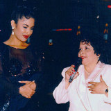 Selena (left) with fan club president and, later, convicted murderer Yolanda Saldivar at a Tejano Music Awards party in 1994.