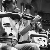 Veronique Serret, right, in the Australian Youth Orchestra in 1996 with Helen Ayres.