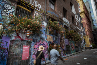 Hosier Lane, where pedestrians take selfies in front of the ever-changing street art canvas.