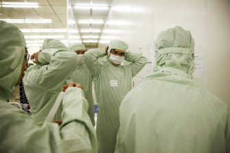 Employees put on clean suits at Semiconductor Manufacturing International Corp (SMIC), in Shanghai, China, which has been targeted by US authorities.