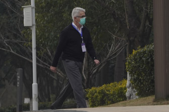 Dominic Dwyer, member of the World Health Organization team, walks in the cordoned hotel area in Wuhan in central China's Hubei province in February.